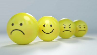 Smiley face yellow balls illustrating different emotions