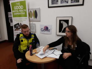 Updating a local police officer on purpose of the drop-in Cafe